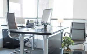 Clean serviced office space with clean desks and chairs