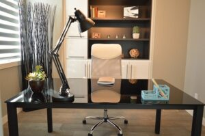 Home office with a clean black desk and white chair